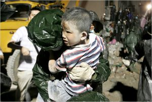 A boy being rescued in Dujiangyan.