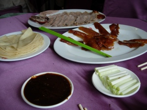 Sliced duck meat & skin with pancakes, hoisin sauce and onions