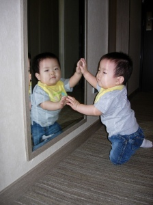 Fascinated with the baby in the mirror